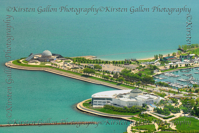 Adler Planetarium is on the left and the Shedd Aquarium is in the lower right corner.  View is from the Sears/Willis Tower.