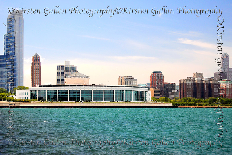 The east side of Shedd Aquarium as seen from the planetarium park.