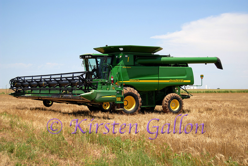 One of the biggest combines John Deere makes.  This one gets a little rest after the area had been hit with lots of rain making it difficult to get into the field to cut.  You can see the heavy traces of mud on the tires.