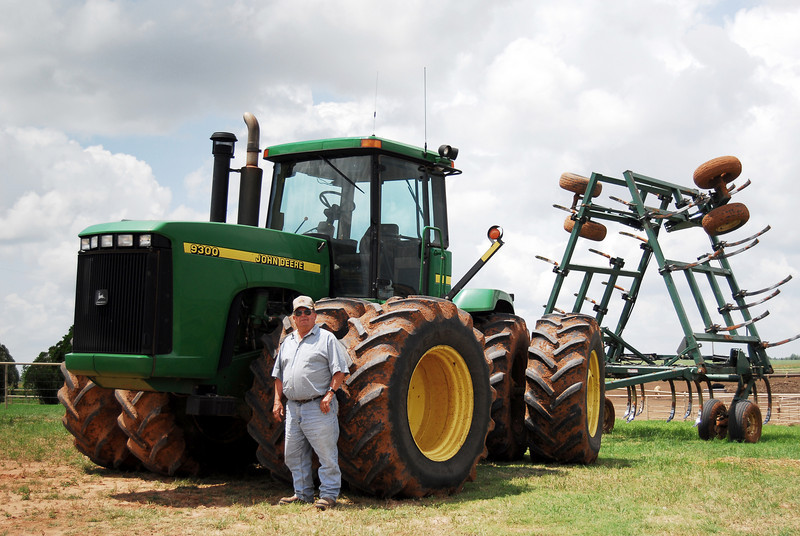 Dad, a John Deere tractor, and a spring-tooth attachment.  I got to spring-tooth plenty of wheat fields during the summer.