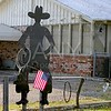 American flag with cowboy man silhouette