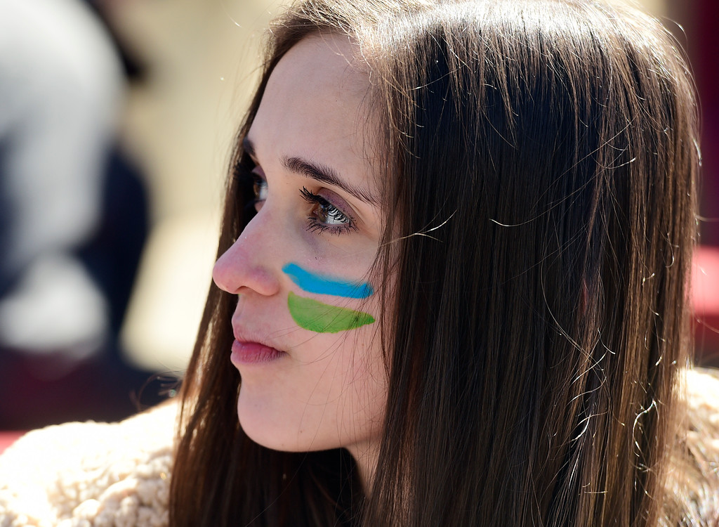 . BOULDER, CO - March 15, 2019: Allie Hummer, of Silver Creek High School, wears the colors of fighting climate change. Boulder area students as well as students from Conifer and Leadville gathered at the Central Park bandshell and marched around downtown Boulder. Around the world, thousands of young people are demanding action on climate change. Some students in Colorado are preparing to miss class Friday as part of the U.S. Youth Climate Strike. (Photo by Cliff Grassmick/Staff Photographer)