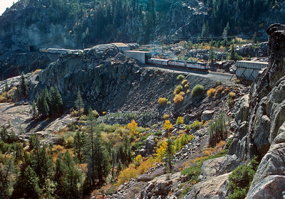 October 1989.  The westbound Amtrak Cal Zephur climbs Donner on Track 1, the original Central Pacific crossing of the Sierras, and now removed.