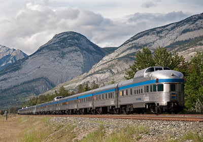 During the summer season The Canadian is a long train and does a land office business.  Here a late June train heads east from Jasper through the rugged mountains of Jasper National Park.