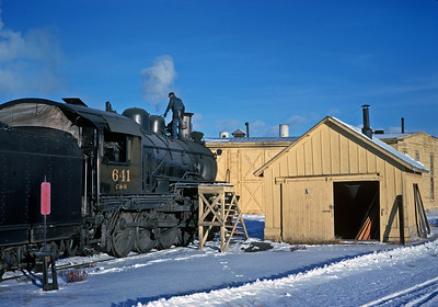 December 15, 1961.   Leadville, Colorado.  The isolated C&S branch from Leadville to Climax remained steam operated long after the rest of the Burlington System was dieselized due to uncertainty how diesels would perform at the high altitude.  The end of the branch at Climax was over 11,000 feet in   altitude, the highest station on an standard gauge adhesion railroad in the U.S.
