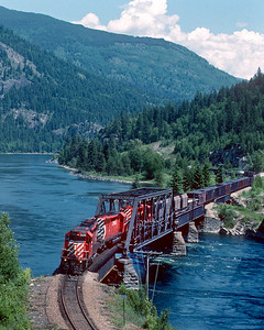 A westbound train from Nelson to Trail crosses the Kootenay River just west of Nelson.  June 1990.