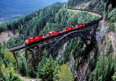 September 8, 1988.  Eastbound empty coal train on Stoney Creek bridge on the Rogers pass line. The bridge is 325 feet above the creek bed.