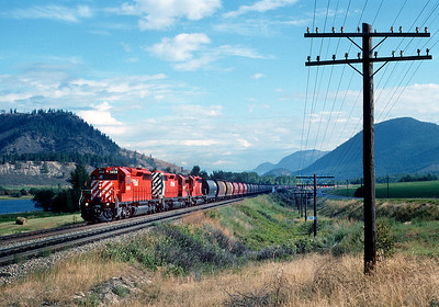 September 1988.  A grain train heads toward Kamloops past MP 104.