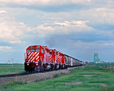 June 1990.  The Coutts turn passes some prairie skyscrapers enroute back to Lethbridge.