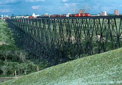 June 1990.  The Coutts turn crosses the Lethbridge viaduct on its way back to Lethbridge yard.