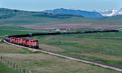 A manifest with a then new Red Barn on the point heads east from Crows Nest Pass.  June 1990.