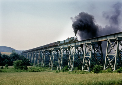 The Independence Limited on the now abandonned Western Maryland Salisbury Viaduct near Meyersdale, PA. The 4501 was making a ferry move from Pittsburg to Hagerstown via the P&WV and WM. Thanks to several viewers for this information.  July 1973.