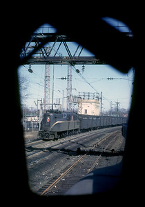 "March 1962. View from the fireman's seat on a GG-1. I bummed a cab ride on a freight from Lancaster to Camden. Got the following location backchannel: ""You're eastbound approaching Paoli, PA on No.2 track, passing the helper pocket track between Nos.2&3 main and coming underneath Paoli's eastward home signals."" Thanks."