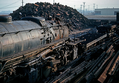 One of Southern Pacific's magnificent cab forward articulated locomotives awaits its fate in a South San Francisco scrap yard. The tender has already been cut down to its frame, and the locomotive will soon follow. The saddest image in my collection.  January 1959.