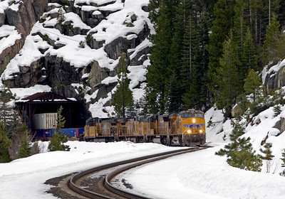 January 8, 2010.  A westbound stack train exits Tunnel 35 at Yuba Gap on an overcast winter day.