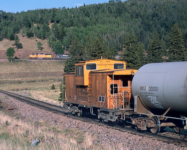 June 2001.  Eastbound climbing around the loop approaching La Veta pass on the line between Alamosa and Waldenburg.
