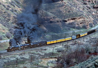 April 1981,   This is the rather odd train that the two engines dragged to Sacramento for Railfair,  Approaching Ogden.