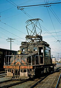 """This is my only """"real"""" Sacramento Northern photo, taken at Yuba City in April 1964.  A small segment of SN electrification lasted until 1965 for switching around Marysville and Yuba City. All this trackage is gone now, including the connection into Marysville. The 653 is now at the Orange Empire Railway Museum in Perris, California."""