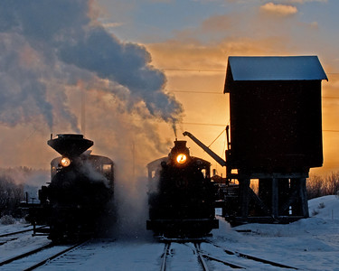 February 1, 2014.  It is snowing lightly as the sunrises at McEwen. Engines 3 and 19 are getting ready for a day of photo ops for Pete Lerro's winter weekend on the Sumpter.