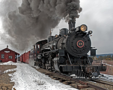 "February 2, 2014.  No. 19 high balls through McEwen and looks bound and determined to make it to Baker City for the first time in 67 years. Eric Wunz, the engineer, claims ""we were doing the yard speed limit of 5 mph and preparing to stop within the 300 feet of track end. Fortunately the breeze was up valley and carrying the smoke plume west as we came through the station eastbound. Brakes were applied so I could work the throttle and lift the smoke up a bit. With 9 cars it stops pretty quick once the throttle was shut"". I dunno, the picture sure looks like Eric was balling the jack."