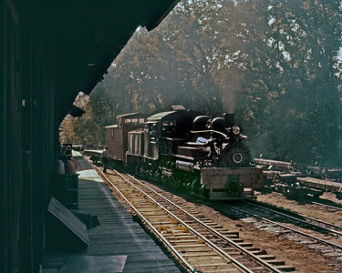 Switching at the mill yard.  Most of the mill yard was three rail to accommodate standard gauge cars used for internal movement of lumber, as well as loading cars for outbound shipment via the Sierra Railroad.  October 1960.