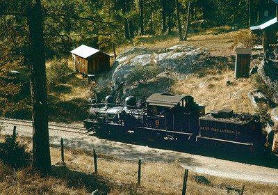A down train passes some of the first signs of civilization as it approaches the mill at Tuolumne.   Note what looks like a one hole outhouse, and perhaps the small building down the hill is a place for the kids.  October 1960.
