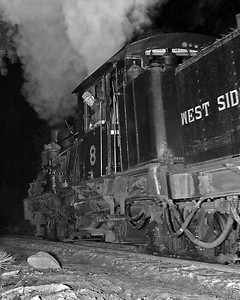It is well before sunrise as No. 8 heads into the woods with a long string of empty log cars. This was during the last season the WSL railroad operated, and was one of my earliest efforts at night photography.  I guessing that is Len Ames look down at me from the fireman's seat.  October 1960.