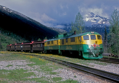 June 2003.  A Trains Unlimited charter sits in the siding at Glacier waiting for one of the regular trains to pass. The scenery on the White Pass is great rain or shine, but when the sun does shine it is really something special. I have added the WPY marks to the loco number, because in researching some old Equipment Registers, even though White Pass had no equipment in interchange service, the AAR did assign them the WPY marks for accounting purposes.
