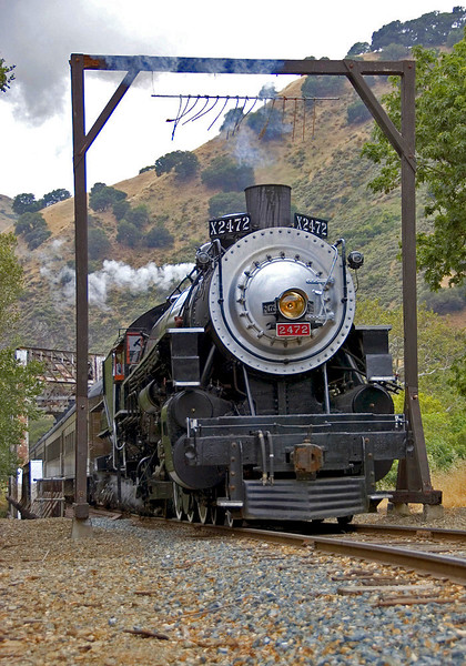 The exhaust from SP 2472 blasts the telltales as she pulls a photo special through Niles Canyon. I had almost forgotten telltales, one of the many details from the old days that are largely missing from the railroad scene these days. They warned anyone riding the car tops that a low obstruction was ahead, in this case the through truss bridge in the background. The 2472 is owned by the Golden Gate Railroad Museum, and has been recently returned to service on the ex-SP Niles Canyon Railway of the Pacific Locomotive Association. Nice matching train of old heavyweight cars.  May 24, 2008.