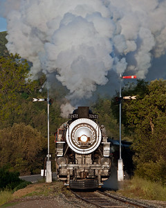 SP 2472 splits the oft photographed semaphores at Sunol shortly after sunrise on a cool spring morning.  March 27, 2010.