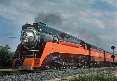April 1986.  Returning north via the Valley line following a movie making appearance in Southern California. Cooking along at track speed with a perfect economy haze from the stack. Somewhere north of Fresno.