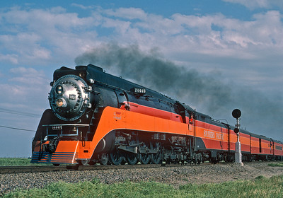 April 1986.Following movie work in Southern California, SP 4449 makes a high speed run north through California's Central Valley. The Road Foreman would appreciate the economy haze, and that traditional SP searchlight signal is a nice touch.  April 1986.
