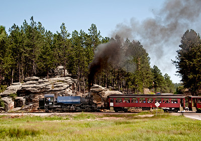 July 30, 2011.  Heading west from Keystone.  The engines run around the train but don't turn, so they run in reverse from Keystone to Hill City.  At one time there apparently was a turntable at Hill City but no trace of it today as far as I can tell.