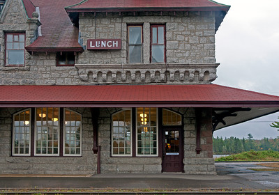 The train station at McAdam, NB.  This was originally a CPR junction on the mainline between Montreal and Saint John, with the branch to the resort town of St. Andrews. The CPR Algonquin Hotel at St. Andrews was a major tourist destination and to deal with passengers making a connection the CPR built an imposing station, hotel, and restaurant.  The railroad is now the New Brunswick Southern, no passenger trains pass this way, and the station complex is now under restoration as a museum.  The former lunch room is open for special occasions.