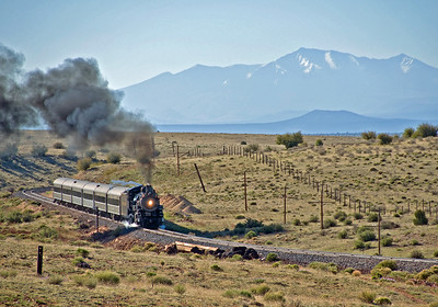 May 15, 2011.  Our charter train makes a morning runby at Miller Wash, MP 36 with the snow capped San Francisco peaks in the distance.