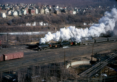 April 1968.  Jim Thorpe, PA.  On a bitterly cold early spring day Strasburg 90 (newly acquired from the Great Western) and High Iron Company 127 (ex-CPR 1278, later of Gettysburg Railroad boiler explosion infamy...thanks for confirming that Mitch) doublehead a High Iron Company excursion north out of Jim Thorpe on the CNJ. I believe that is the Lehigh Valley mainline on the other side of the river. I wonder how much of the trackage shown in the picture still exists, and who operates it....not to mention the turntable. Corrections on the above info are welcome, since it has been a long time and I'm writing this from memory.