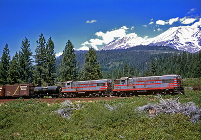 MR 34 leads the 29 climbing the grade out of Mount Shasta city where the McCloud connected with the SP. No. 34 is ex-SP 5253 and appears to still have its SP train number indicators showing it as X34.  July 1964.