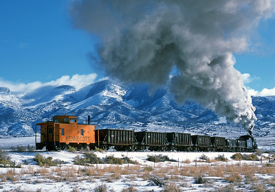 February 2004.  A Kennecott ore train heads east from East Ely on the mainline toward Hiline junction and the hiline branch to McGill. All recreated by the Nevada Northern museum of course.
