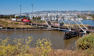 August 18, 2011.  The old NWP swing bridge at Petaluma.  SMART replaced this with a recycled drawbridge obtained from Galveston, Texas.  Until SMART began passenger operations the NWP ran trains during the day making these picture possible.  Beginning in late 2017 all NWP freights ops are at night.
