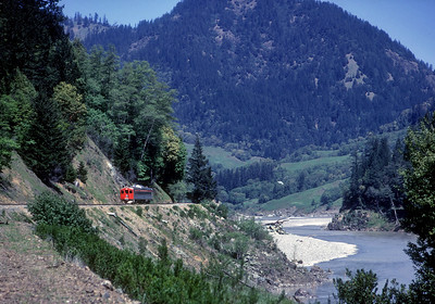 April 1969.  The NWP (SP) Budd car heads south from Eureka to Willits on its tri-weekly roundtrip through the scenic Eel River canyon.