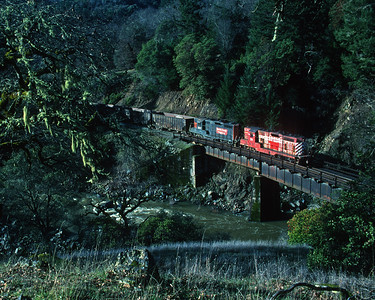March 1998.  The North Coast Railroad heads north from Willits along Outlet Creek.  The last operation over the north end was not long in the future.