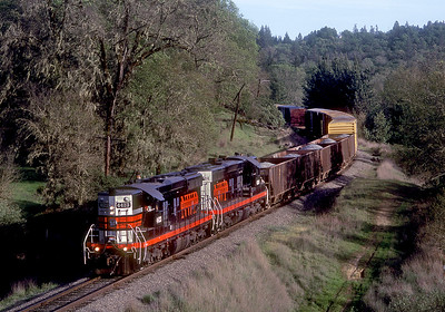 Coming down the hill to Willits.  The new NWP spent a lot of money on fancy paint jobs that looked really nice, but the mechanical reliability of the units leased from Omni Tracs left a lot to be desired.
