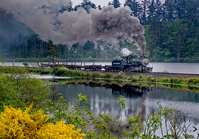 Smith Lake causeway.  In the distance behind the train is Milepost 843.  843 miles from San Francisco when the old Tillamook branch was part of the SP.