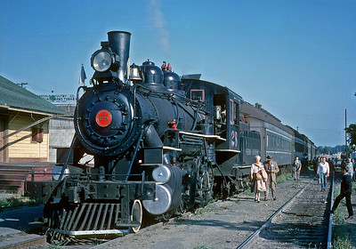 May 1961.  Oakdale.  I think that is the old SP station behind the engine.  Note bright paint on the domes and old style headlight.  The 28 had been painted up for movie work, and the day before the excursion a small group of us had painted over the red and silver domes and gold headlight, but did not have time to repaint the red highlighting of the cab numbers.  This was a Central Coast Railway Club excursion.