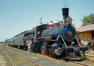 This was an excursion on the Sierra that originated on the Santa Fe at Richmond with the three charter cars on the rear of a Bakersfield passenger to Riverbank, where a switchengine hauled the train to Oakdale where the Sierra took over. In the background you can see the Santa Fe engine that had brought to the train to Oakdale. The 28 had obviously had a movie assignment prior to this excursion.