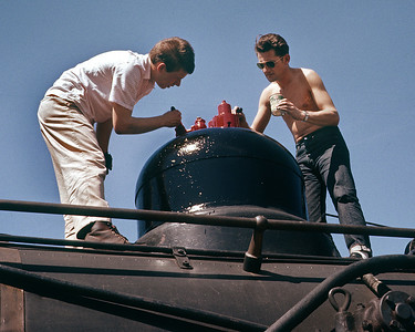 May 1961.  Terry Barns and Bob Mangels paint one of the domes on the 28 in preparation for the Central Coast photo charter.