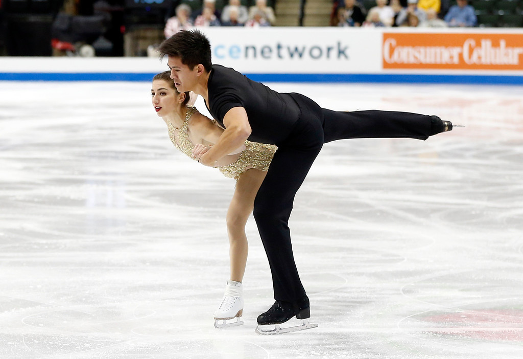 . Pairs skaters Marissa Castelli, left, and Mervyn Tran perform in the short program of the U.S. Figure Skating Championships, Thursday, Jan. 21, 2016, in St. Paul, Minn. (AP Photo/Jim Mone)