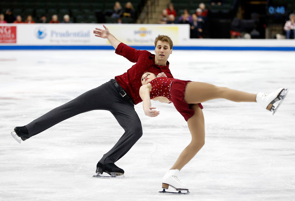 . Pairs skaters Alyssa McDougal and Paul Schatz perform in the short program of the U.S. Figure Skating Championships, Thursday, Jan. 21, 2016, in St. Paul, Minn. (AP Photo/Jim Mone)