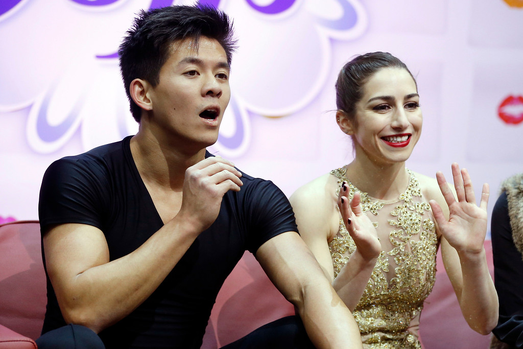 . Pairs skaters Marissa Castelli, right, and Mervyn Tran await the results in the short program of the U.S. Figure Skating Championships, Thursday, Jan. 21, 2016, in St. Paul, Minn. (AP Photo/Jim Mone)