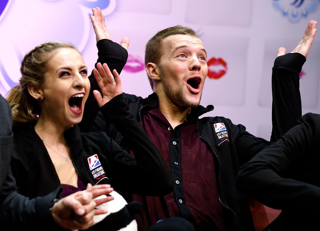 . Pairs skaters Tara Kayne and David OíShea celebrate after finishing in first place perform in the short program of the U.S. Figure Skating Championships, Thursday, Jan. 21, 2016, in St. Paul, Minn. (AP Photo/Jim Mone)